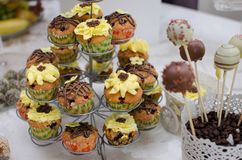 Candy bar. With cupcakes and muffins on a tiered rack stock images