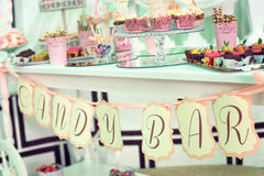 Candy bar with different sweets on dinner or event party Stock Photos