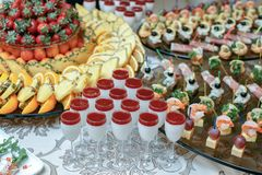 Candy bar with fresh summer fruits prepared for reception Royalty Free Stock Photo