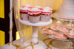 Candy bar marshmallow on the table in a vase, a plate in pink, macaroon, cake and cupcake, holiday, birthday, decoration Royalty Free Stock Photos