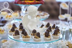 Candy bar. Pastries and chocolate cakes on stand on a holiday. royalty free stock photography