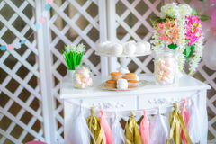 Candy bar in pink colors for a children`s party Royalty Free Stock Photography