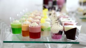 Candy bar in the restaurant. Wedding pastries on sweet table. stock video footage