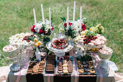Candy bar in sunny wedding day Royalty Free Stock Image