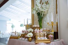 Candy bar. Table with sweets, buffet with cupcakes, candies, dessert. Stock Photography