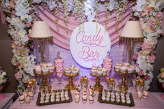 Candy bar. Table with sweets, candies, dessert Stock Photos