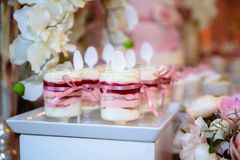 Candy bar and wedding cake. Table with sweets, buffet with cupcakes, candies, dessert. Royalty Free Stock Photography