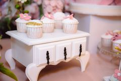 Candy bar and wedding cake. Table with sweets, buffet with cupcakes, candies, dessert. Royalty Free Stock Photo