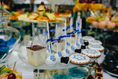 Candy bar on wedding ceremony. With a lot of different candies and beverages stock photo
