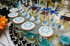 Candy bar on wedding ceremony. With a lot of different candies and beverages stock photos