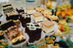 Candy bar on wedding ceremony. With a lot of different candies and beverages stock image