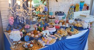 Candy bar on wedding ceremony with a lot of different candies and beverages stock video