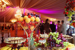 Candy bar. Wedding candy bar with fresh fruits and cakes Stock Photos