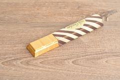 A candy bar with a wrapper. On a wooden background Stock Photo