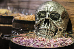 Candy in a barrel and a skull Royalty Free Stock Photos