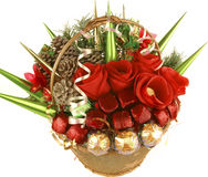 Candy basket gift for new Year celebration. Gold metal basket with handwrapped decorated candies. the image has round and square candy covered with gold and red Stock Image