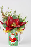 Candy baskets gift cup with new year theme of decor. Vertical image with  holiday decorated green cup. The cup has image of Santa Claus. On the top of the cup is Stock Images