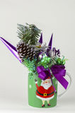 Candy baskets gift for new year decoration. Holiday decorated green color cup with image of Santa Claus on it. The image has colorful theme for Christmas Royalty Free Stock Photography