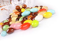 Candy beans with glass jar on white Royalty Free Stock Photos
