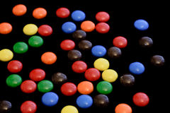 Candy on black background - horizontal Stock Images