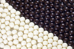 Candy black and white balls background Stock Photos