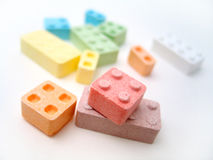 Candy Blocks. Colored candy blocks scattered on white background. Focus on front blocks Royalty Free Stock Photos