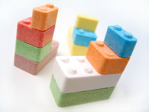 Candy Blocks II. Colored candy blocks scattered on white background. Focus on front blocks royalty free stock images