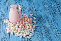 Candy on a blue pastel colored background Stock Photo