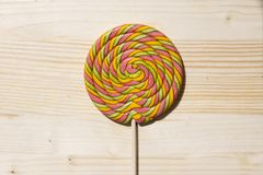 Lollipops on a wooden surface background Royalty Free Stock Photo