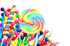 Candy border. Colorful candy corner border with lollipops and gumballs Royalty Free Stock Photos