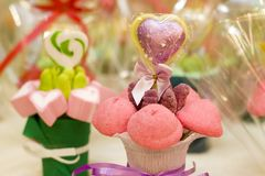 Candy bouquet. A sweet bouquet over colorful background Royalty Free Stock Photo