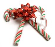 Candy bow. Two christmas candy canes and a bow Stock Images