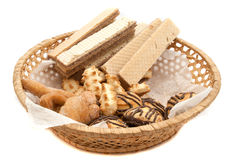 Candy bowl. Wicker tray with biscuits and wafers royalty free stock image