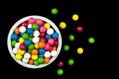 Gumballs bounced out of a bowl Royalty Free Stock Image