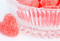 Candy. A bowl of Red valentine candy hearts stock photos