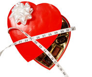 Candy box wrapped with tape measure Royalty Free Stock Photos