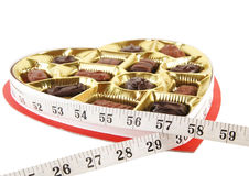 Candy box wrapped with tape measure Stock Images