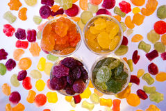 Candy brightly colored in the glass cups. Royalty Free Stock Photos
