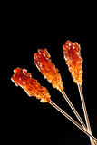 Candy brown sugar on a stick Royalty Free Stock Image