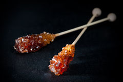 Candy brown sugar on a stick Royalty Free Stock Photo