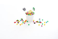 Candy. A bucket full of candy that has spilled over stock photo