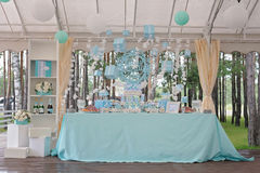 Candy buffet with cupcakes and other desserts. Candy Bar. Delicious sweet buffet with cupcakes. Sweet holiday buffet with cupcakes, champagne and other desserts Stock Photography