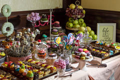Candy buffet and desert table. Fancy chocolate striped marshmallows, and an assortment of candy on the candy buffet and dessert tables at a reception Royalty Free Stock Photos