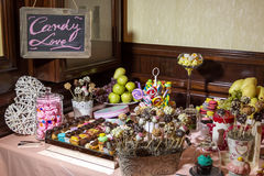 Candy buffet and desert table. Fancy chocolate striped marshmallows, and an assortment of candy on the candy buffet and dessert tables at a reception Royalty Free Stock Image