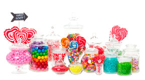 Candy Buffet. A candy buffet with a wide variety of candies in apothecary jars.  Shot on white background Royalty Free Stock Photo