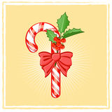 Candy cane. On bright background Royalty Free Stock Image