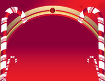 Candy cane background. Candy canes on a curved red background Royalty Free Stock Images