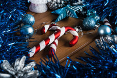 Candy cane on the background of Christmas decorations. Christmas candy cane on wooden table Stock Image
