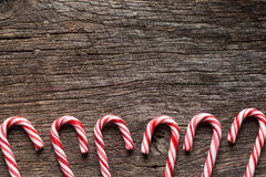 Candy cane background. Old barn wood with candy canes lined at the bottom Royalty Free Stock Photo