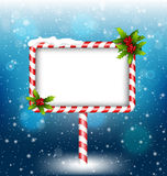 Candy cane billboard with holly in snowfall Stock Image